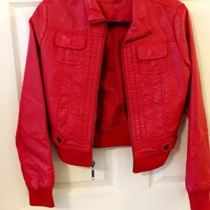 Red faux leather jacket w/pockets & zips up